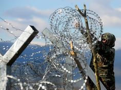 A Macedonian army soldier finishes a razor-wired fence at the border with Greece, near Gevgelija, The former Yugoslav Republic of Macedonia on Nov. 29, 2015. Macedonia, Serbia and Croatia had started restricting access to migrants on the Balkan route to Syrians, Iraqis and Afghans. It is a part of a joint effort to reduce the number of asylum seekers streaming into the European Union.  Nake Batev, european pressphoto agency