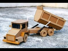 How to make a RC dump truck at home at home. in this video I will guide you: How to make Powerful dump truck from Cardboard with DC motor at home. Cardboard Playhouse, Cardboard Toys, Cardboard Furniture, Wooden Toy Trucks, Wooden Toys, Recycled Crafts, Diy Crafts, Paper Crafts, Helicopter Craft