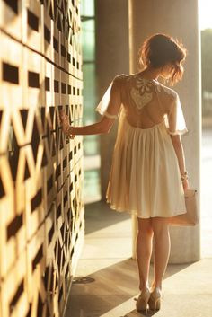 photography lighting against stone lattice wall and girl with frock