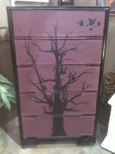 mid-century modern dresser, my husband free-hand painted this tree on it! He's so incredibly talented!