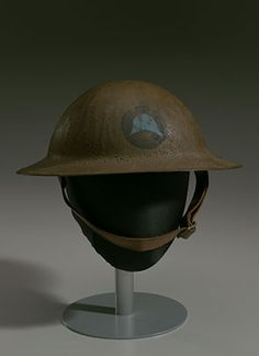 """""""Brodie"""" style World War I combat helmet, Infantry Division of the United States Army, active between (Smithsonian National Museum of African American History and Culture). Combat Helmet, Army Helmet, Henry Johnson, Black Death, American Red Cross, United States Army, African American History, National Museum, World War I"""