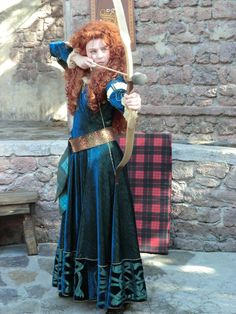 Gorgeous Merida Cosplay. This looks like it might be the character from Disneyland/Disney World. This is an excellent cosplay if it isn't from the parks.