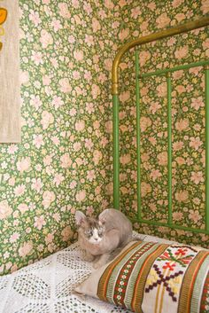 Gorgeous greens. Love the wallpaper & bed.