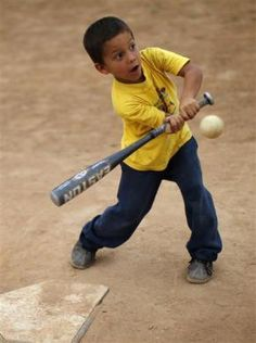 A boy bats during a baseball practice in the coastal town of Ocumare, February 25, 2011.  REUTERS/Jorge Silva