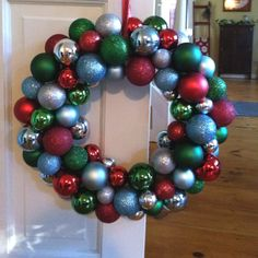 The do-it-yourself Xmas wreath using ball ornaments.  So easy!