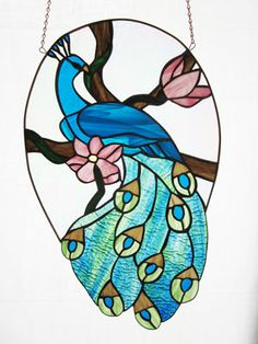 Stained glass artwork by JoAllyn & Mark Vlossak. See their work at the Fine Art and Crafts at Verona Park #stainedglass #Wallhanging #crafts #rosesquared