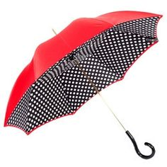 Double canopy featuring a red exterior with white polka dots set against a black interior. 100% Handmade in Italy