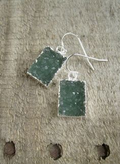 Simple earrings showcase glittering jasper quartz druzy drops.  Natural druzy drops are a most rare and beautiful deep sea green color, framed in silver electroplate for a polished finish - the backs are left natural to allow light to pass through. These stones are 100% natural, meaning they have not been dyed, treated or enhanced in any way. They are an amazing quality and sparkle irresistibly when they catch the light! Total hanging length is approximately 1 from top of sterling silver…
