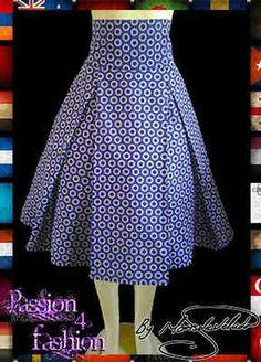 Shweshwe traditional skirt with a high wide waistband and large pleats in purple circular shweshwe pattern. Marisela Veludo, Passion4Fashion