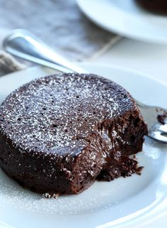 Restaurant-style gluten free chocolate lava cakes with a warm, gooey center. For…
