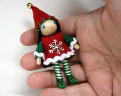 Small bendable elf doll.  She's just about 3 inches tall.  Can be used as an ornament or for play.  Kindness Elf handmade by www.PNTdolls.com