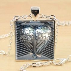 lady bikers and biker chicks will recognize this bling piece of motorcycle accessory love wings petite silver setting features gorgeous shiny chrome wings