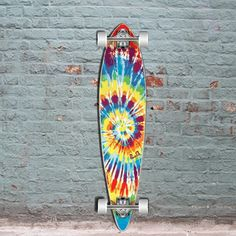 The Punked Tiedye Original is a great flat pintail longboard made of Canadian Maple. Cheap 40 inch longboard skateboard for carving and sliding. Ships Free