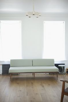 The midcentury modern couch that came with 70s plaid cushion covers. The wonders of reupholstery.