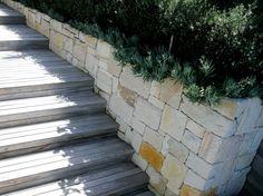 Dimension stone wall, Bungan Beach by Formed Gardens.