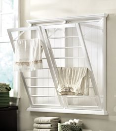 Use an empty wall in a small laundry room to dry clothes. HomeDecorators.com