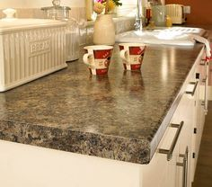 Jamocha Granite Formica. I keep going back to this one. Love it with the white cabinets!