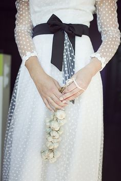 swiss dot lace vintage wedding dress. I wonder why this bride is carrying garlic???