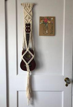 That looks so much cooler than just my ukulele its bag and either in my room leaning against my desk or sitting on my couch😂 Ukulele Case, Ukulele Songs, Music Guitar, Etsy Macrame, Painted Ukulele, Ukulele Accessories, Ukulele Design, Guitar Hanger, Macrame Projects