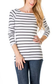 This black and white stripe shirt is a wardrobe must-have. Featuring a boat neck, three quarter sleeves and an all over horizontal striped print.