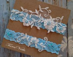 Description: ○ Wedding garter set, bridal garter, Lace Garter.  Made of: ○ This delicate garter set is made of White and light Gold Floral lace,Sequins, beads, with white or Ivory elastic lace.  Tradition ○ Traditionally, the wedding garter is worn on the left leg while the toss garter is worn on the right leg; however, you can wear the two together on one leg (left, traditionally) if you prefer.   How to measure for a wedding garter ○ When you're wearing a keepsake garter, you'll want to…
