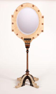 CARLO BUGATTI. A Camelskin, Walnut, Ebonized Wood, Bone, Pewter, and Punched Copper Boudoir Mirror on Stand, circa 1900