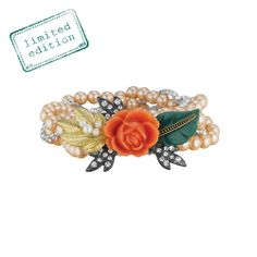 Light peach pearls and clear crystal rhinestone chain form this romantic braided stretch bracelet. Centered with a gorgeous coral rose and leaf motifs, this statement-making piece is too pretty to save for special occasions - wear it everyday! This piece was named by Merchandiser Suzanne Ferrell, in honor of her daughter, Elyse.
