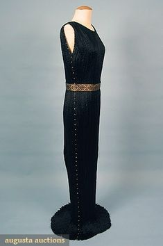 """Black sleeveless sheath w/ caramel striped Murano glass beads on sides & gold stencilled black silk belt, stamped """"Fortuny Depose"""" in dress selvage & back of belt, B 28""""-34"""", Front L 60"""", Back L 62"""", belt buttons at 29"""" & overall length 43"""",(some sections w/ loose pleats) no stains, tears or missing buttons, excellent."""