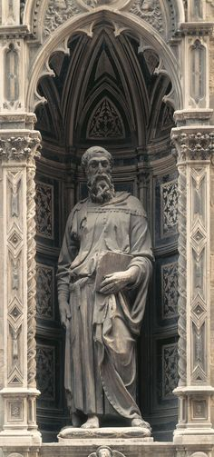 """Donatello, """"Saint Mark"""", 1411-1413, H:236.2cm, Marble, Or San Michele, Florence, Italy. Commissioned by the guild of linen drapers. Donatello reintroduced the use of contrapposto to the early Renaissance. The display of weight shift and movement of the body is shown through the sculpture's slightly bent knees and relaxed posture. By sculpting the clothes with a wet drapery effect not only makes the cloth look like its hanging naturally but enhances the movement created with the body."""