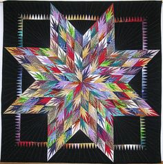 Martha Schellingerhoud Quilts, I took her workshop in 2012, it was fabulous.