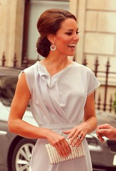 Kate Middleton- love how she always has a smile on her face.:)
