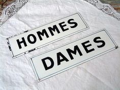 Great for all kinds of decor. Original pair of french enamel signs for the public toliets. They are lightly curved in the center or bombe.  CONDITION :