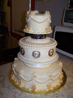 The roses are painted with gold luster dust.   The top tier is red velvet with cream cheese icing.  The middle tier is chocolate cake/caramel filling with buttercream icing and the bottom tier is white cake with 1/2 lemon, 1/2 strawberry filling with buttercream icing.