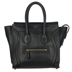 c9cc670a03d3 Curved stitched details and a front logo Celine embossment highlight this  elegant Celine leather tote bag
