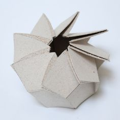 Christine Lee designed these origami gift boxes to showcase her patent-pending recycled fiber board developed with John Hunt at the USDA Forest Products lab.   Laser cut fiber board, flat packed and very easy to assemble!