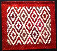 Miniature red and white hexagon quilt by Ellen Carter (Texas).  Photo by Robyn | Patchwork Passion blog