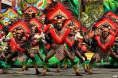 Ati-Atihan.  Located in Kalibo, on the island of Panay, Philippines.  Vestival is crazy , held in honor of the Christ Child, Santo Nino.  Religious festival with three days of chaos (similar to Mardi Gras) in Mid-Janruary.  Kalibo Multicab Terminal