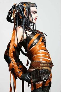 Cyber punk model with industrial dreads and orange pvc