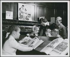 Miss Joan Heatley, librarian, helping a group of children, Willistead Park public library branch... / Mme Joan Heatley, bibliothécaire à la succursale de la Bibliothèque de Willistead Park, aide un enfant à choisir un livre...   Flickr - Photo Sharing!