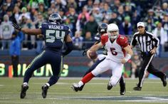 The Seattle Seahawks bottled up the Arizona Cardinals as QB Russell Wilson made enough plays to get the defending champs back into the NFC West race Sunday.
