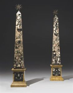 A PAIR OF MONUMENTAL BRECCIA BRUNA AND SIENA MARBLE AND BRONZE OBELISKS 20TH CENTURY In marble and marble veneer, surmounted by a star, resting on four balls on a rectangular socle 81¼ in. (206 cm.) high, 13 in. (33 cm.) square at base (2) Home Libraries, Grand Tour, Pedestal, Decoration, Balls, Bronze, Antiques, Obelisks, Architecture