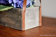 flower trough made from old fence boards and a belt for trim handles