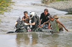 Riding my Yamaha tenere through a river in Mongolia. Getting some help from the…