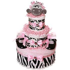 Diaper cake for baby showers .. Obsessed with making these!