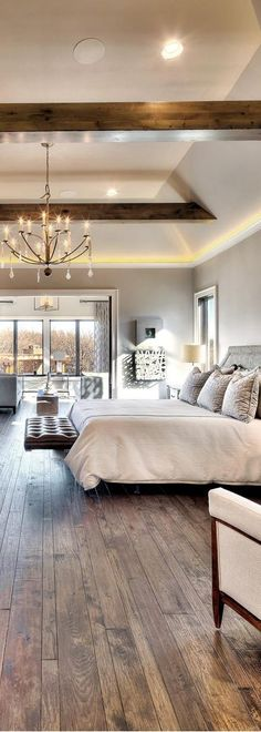 Vintage Interior Design Large modern rustic master bedroom designed by Star Homes with gorgeous wood floors and a contemporary fireplace. Rustic Master Bedroom, Wood Bedroom, Bedroom Flooring, Master Bedroom Design, Home Decor Bedroom, Bedroom Designs, Bedroom Country, Master Bedrooms, Master Suite