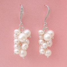 Dangling grape clusters of natural genuine freshwater pearls, combined with a sparkling fancy cz encrusted earwire, create a lovely and elegant bridal earring. Great for bridesmaids as well. Genuine f