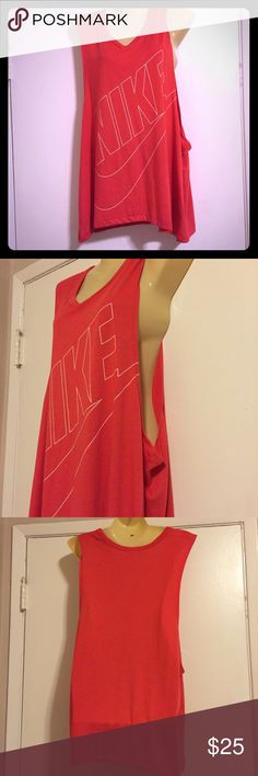 Nike Loose Tank Top Worn once! Just didn't like the color against my skin tone that much. Perfect condition smoke free home no defects Nike Tops Tank Tops