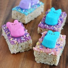 Pastel candy dipped rice krispies treats with Peeps Bunnies decoration for Easter. #foodgawker