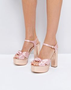 Get this Glamorous's heeled sandals now! Click for more details. Worldwide shipping. Glamorous Knot Mega Platform Heeled Sandals - Pink: Platform shoes by Glamorous, Textile upper, Ankle strap fastening, Knot detailing, Peep toe, High block heel, Wipe with soft cloth, 100% Other Materials Upper. An eclectic mix of vintage influences and contemporary partywear are at the heart of Manchester based label Glamorous, where individual style is the key. The carefully sourced fabrics and prints…