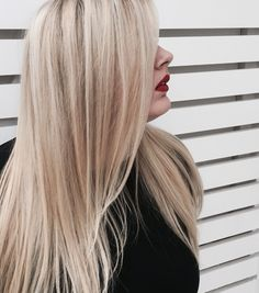 Bright blonde painted highlights and red lips. Hair color by Christina Hiatt.
